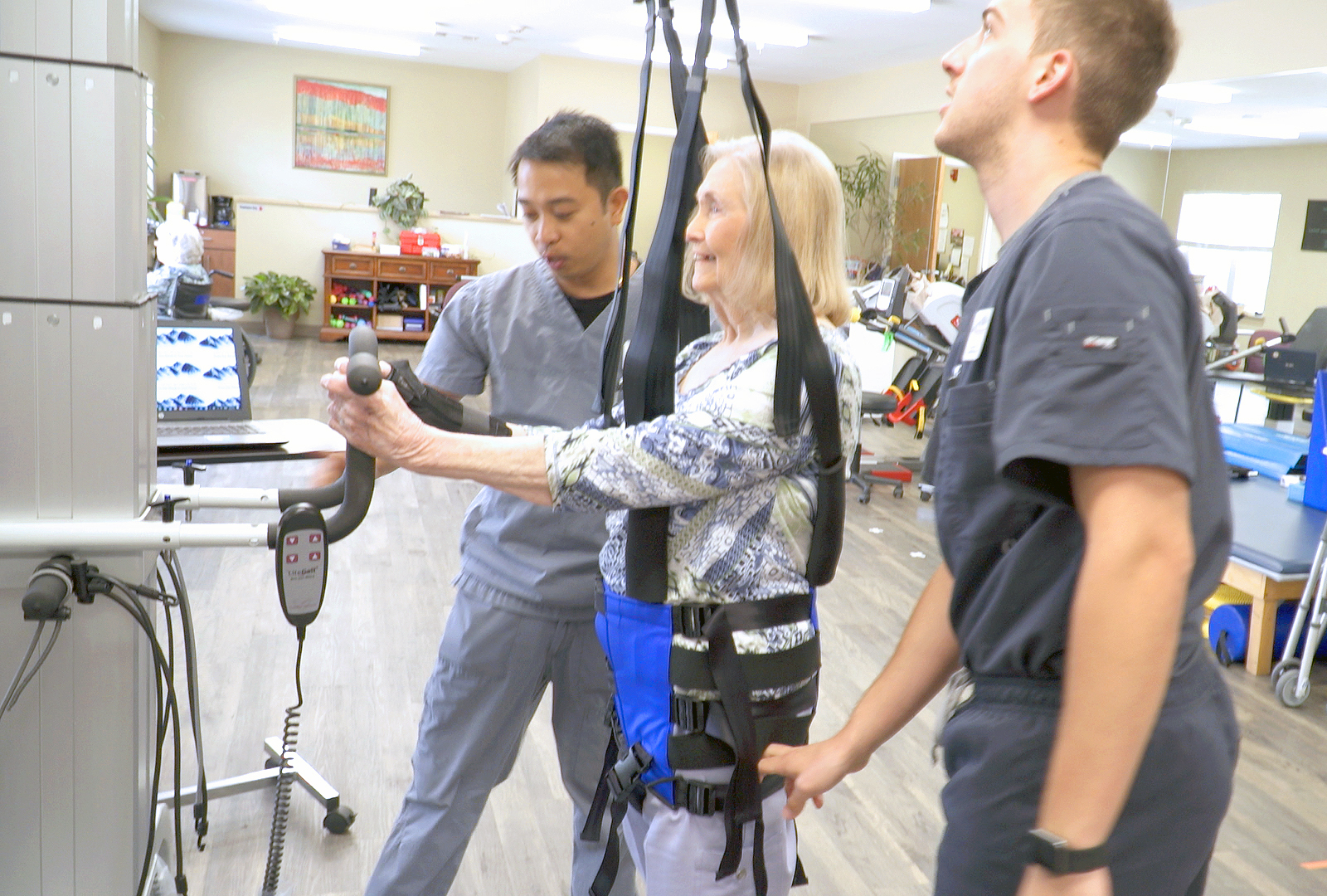Patient with therapists exercising
